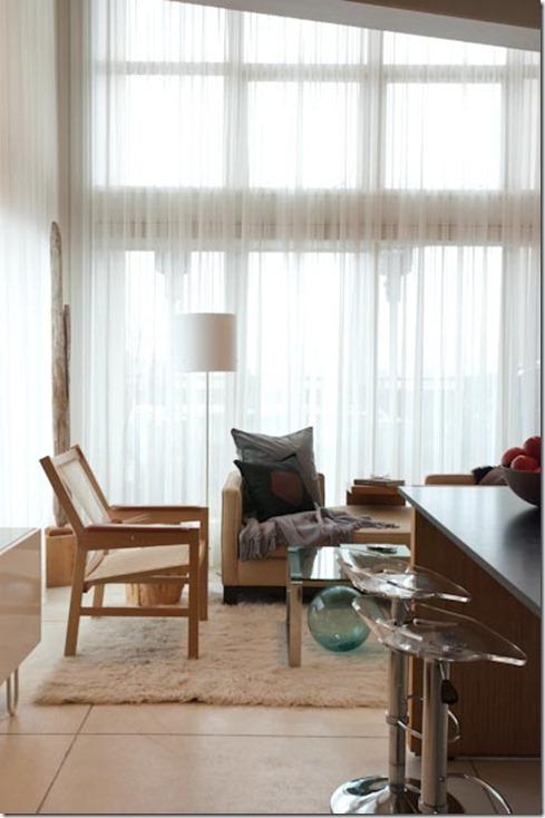 Sheer window panels in modern living room